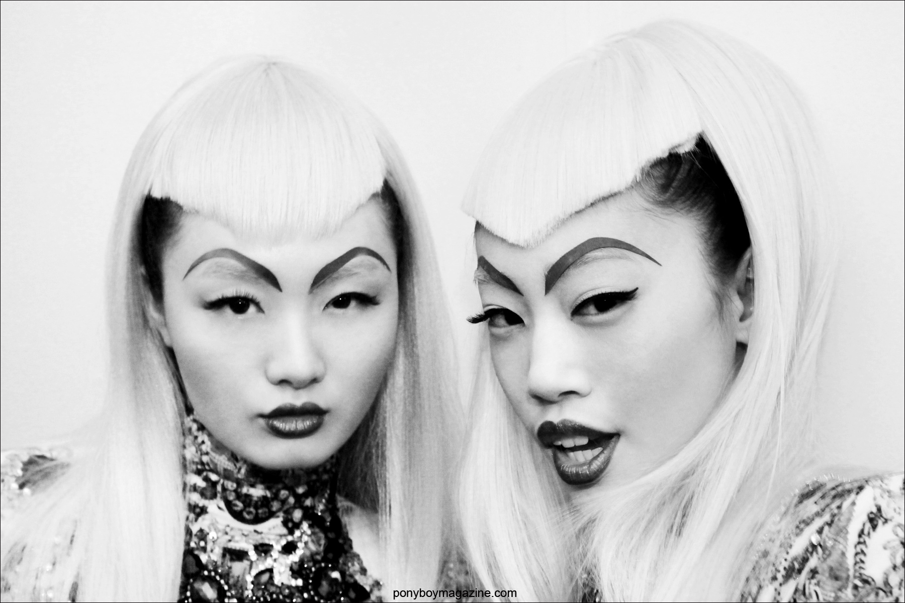 Beautiful Asian models, backstage at The Blonds A/W 2014 show. Photograph for Ponyboy Magazine by Alexander Thompson.