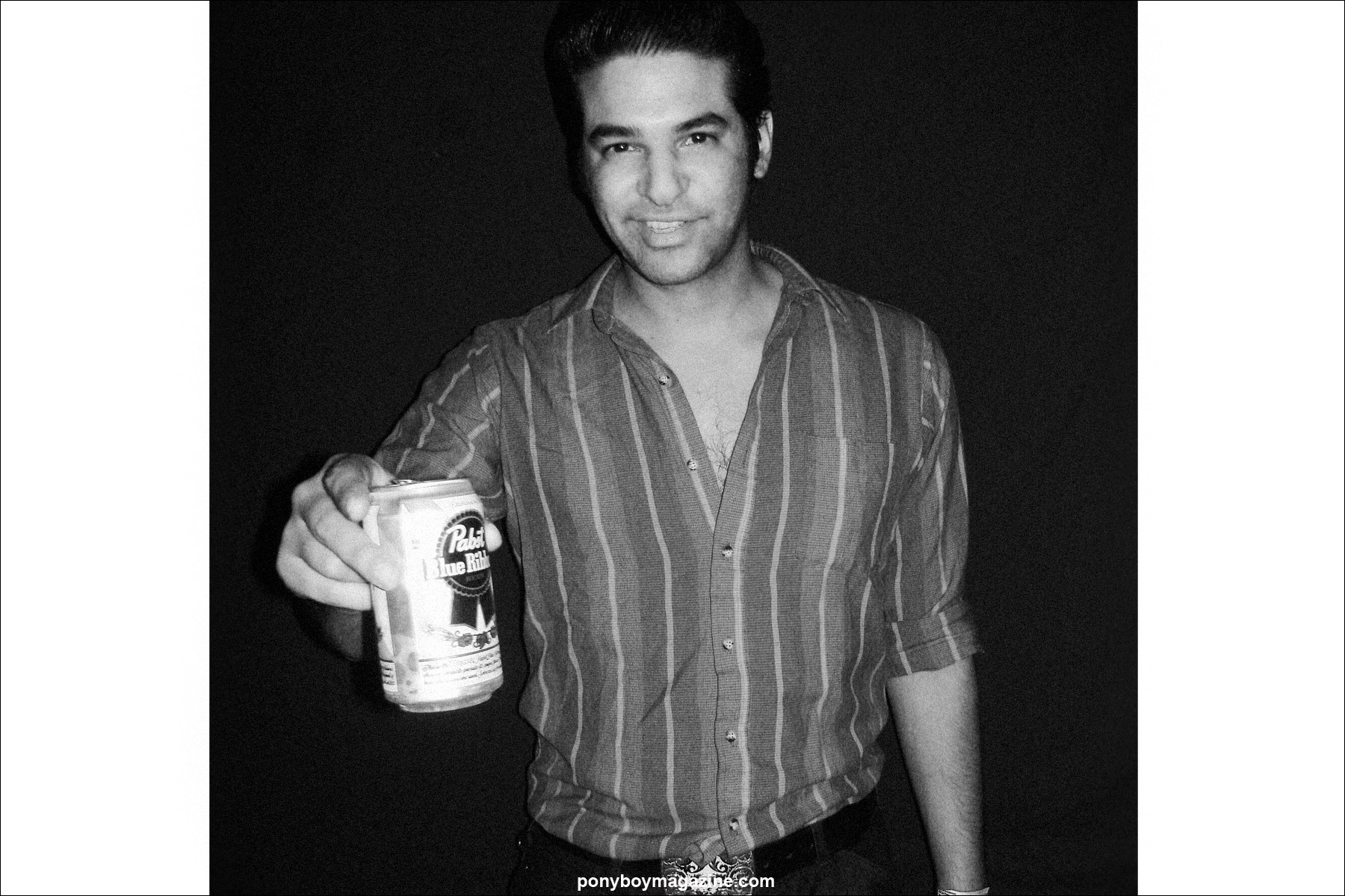 Rockabilly artist Bloodshot Bill, photographed with a PBR beer. Photograph by Alexander Thompson for Ponyboy Magazine in New York City.