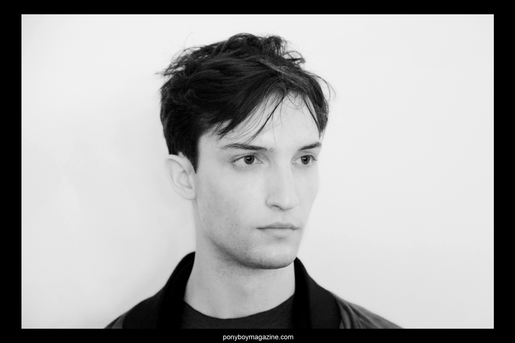 Portrait of male model backstage at the Patrik Ervell A/W 2014 menswear collection, photographed by Alexander Thompson for Ponyboy Magazine.