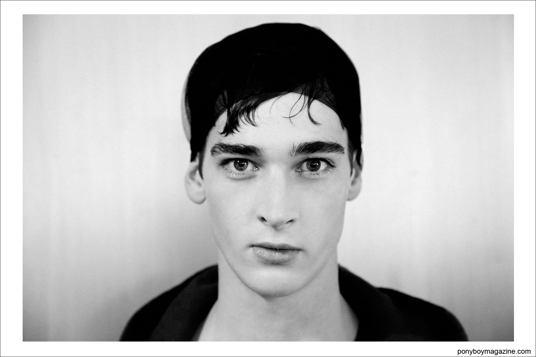 A male model snapped backstage by Alexander Thompson for Ponyboy Magazine at Tim Coppens S/S15.