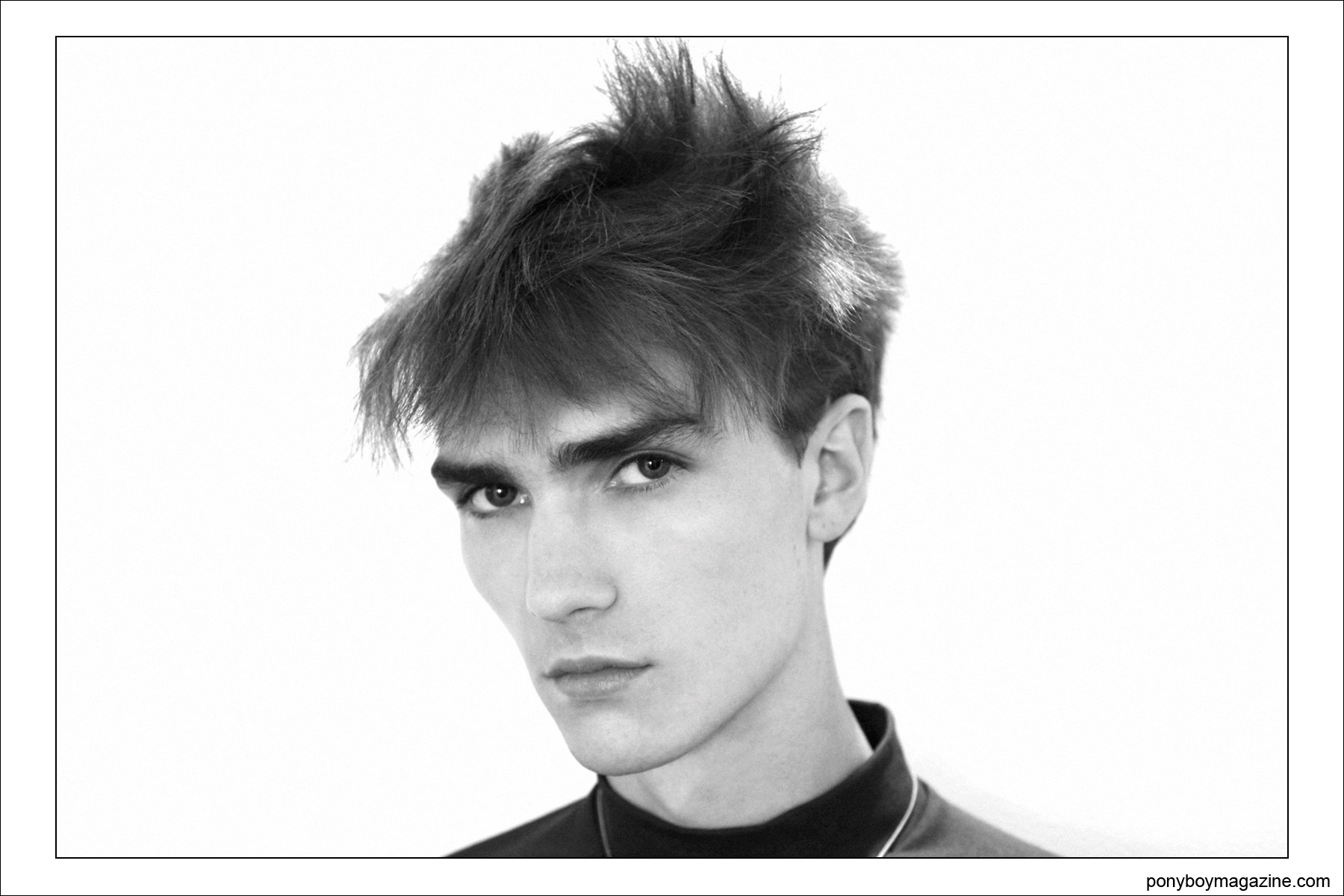 Portrait of a male model with new wave hair, backstage at Patrik Ervell Spring/Summer 2015 by Alexander Thompson for Ponyboy Magazine.