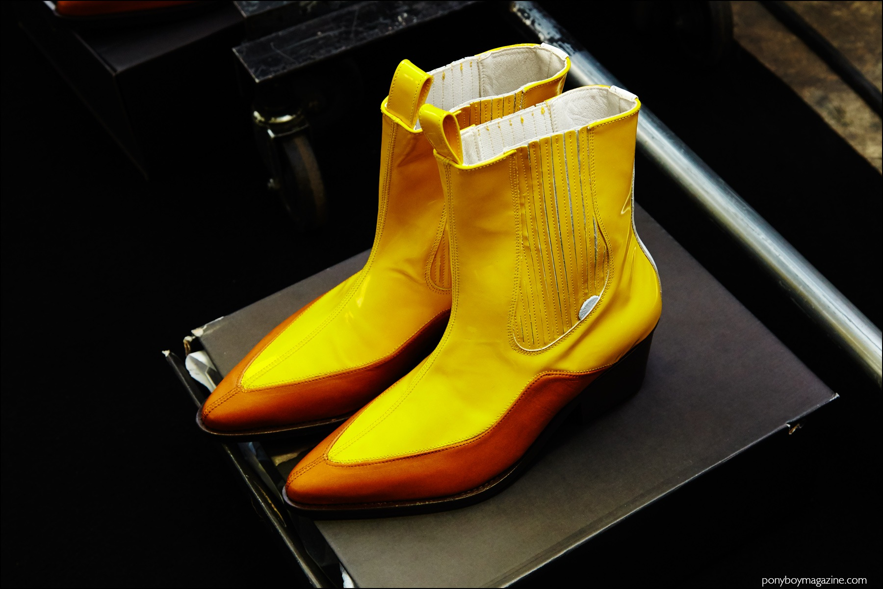A pair of yellow boots, photographed backstage at the Devon Halfnight Leflufy F/W16 menswear show. Photography by Alexander Thompson for Ponyboy magazine NY.