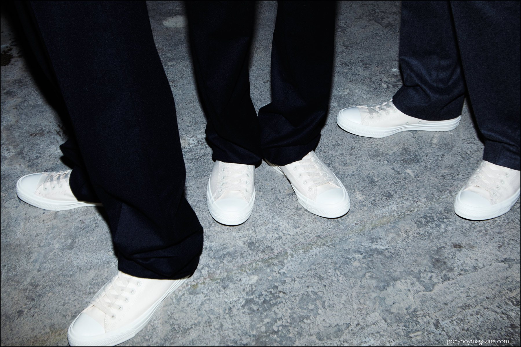 White converse tennis shoes photographed backstage at the Duckie Brown F/W16 menswear show. Photography by Alexander Thompson for Ponyboy magazine NY.