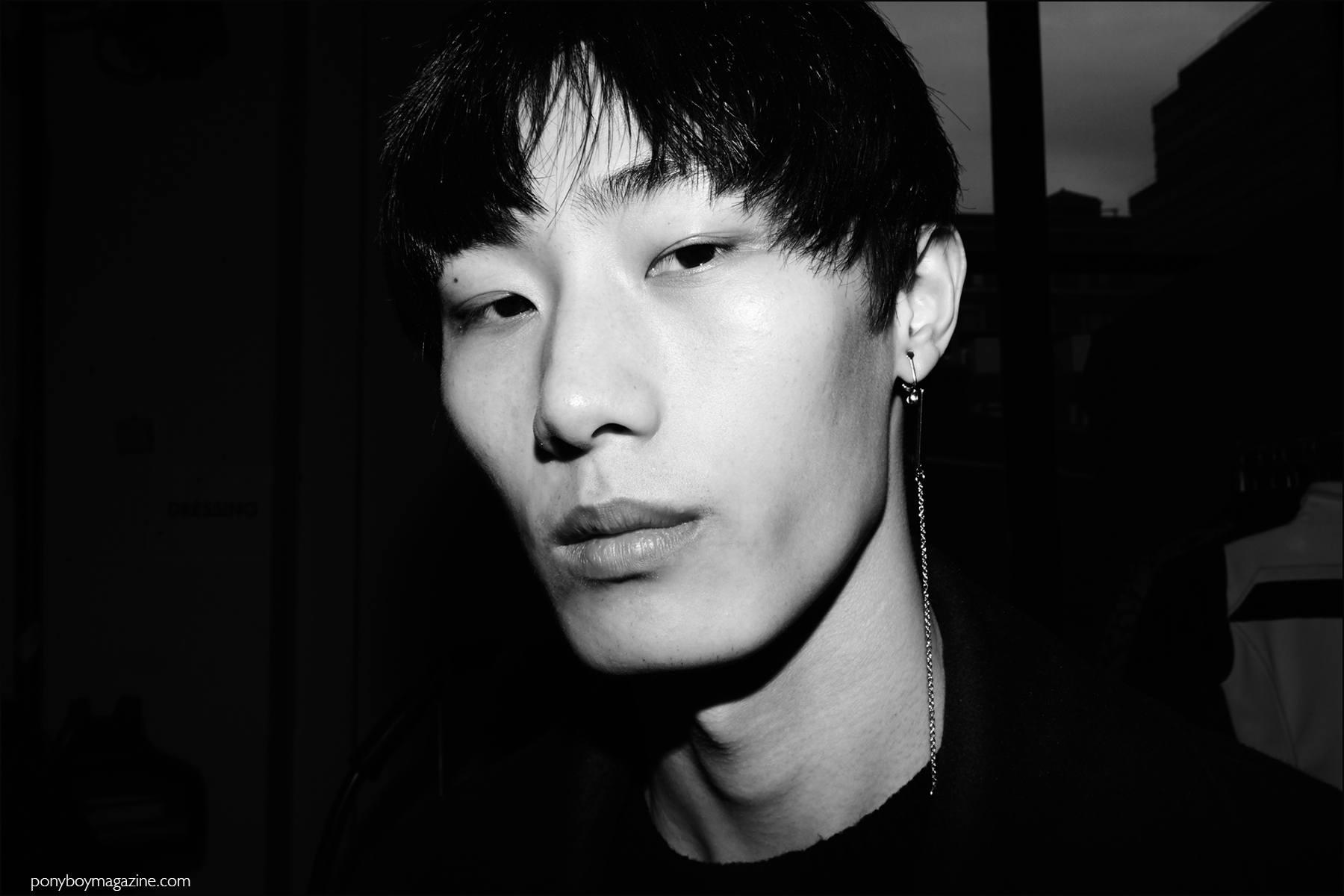 Male model Yan Kai Wen photographed backstage at Kenneth Ning F/W16 menswear show. Photography by Alexander Thompson for Ponyboy magazine NY.