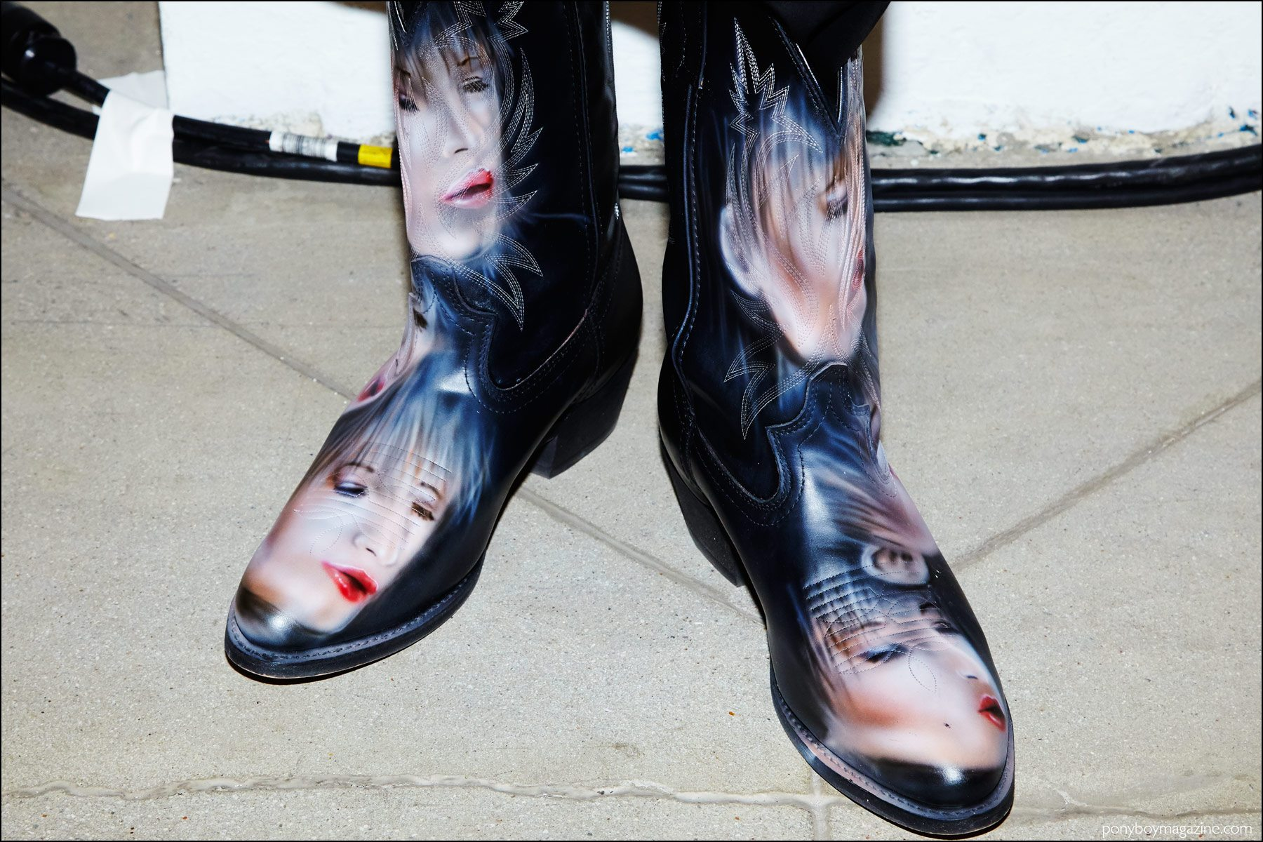 Airbrushed cowboy boots photographed backstage at Devon Halfnight Leflufy S/S17 presentation shown during New York Fashion Week Men. Photography by Alexander Thompson for Ponyboy magazine NY.