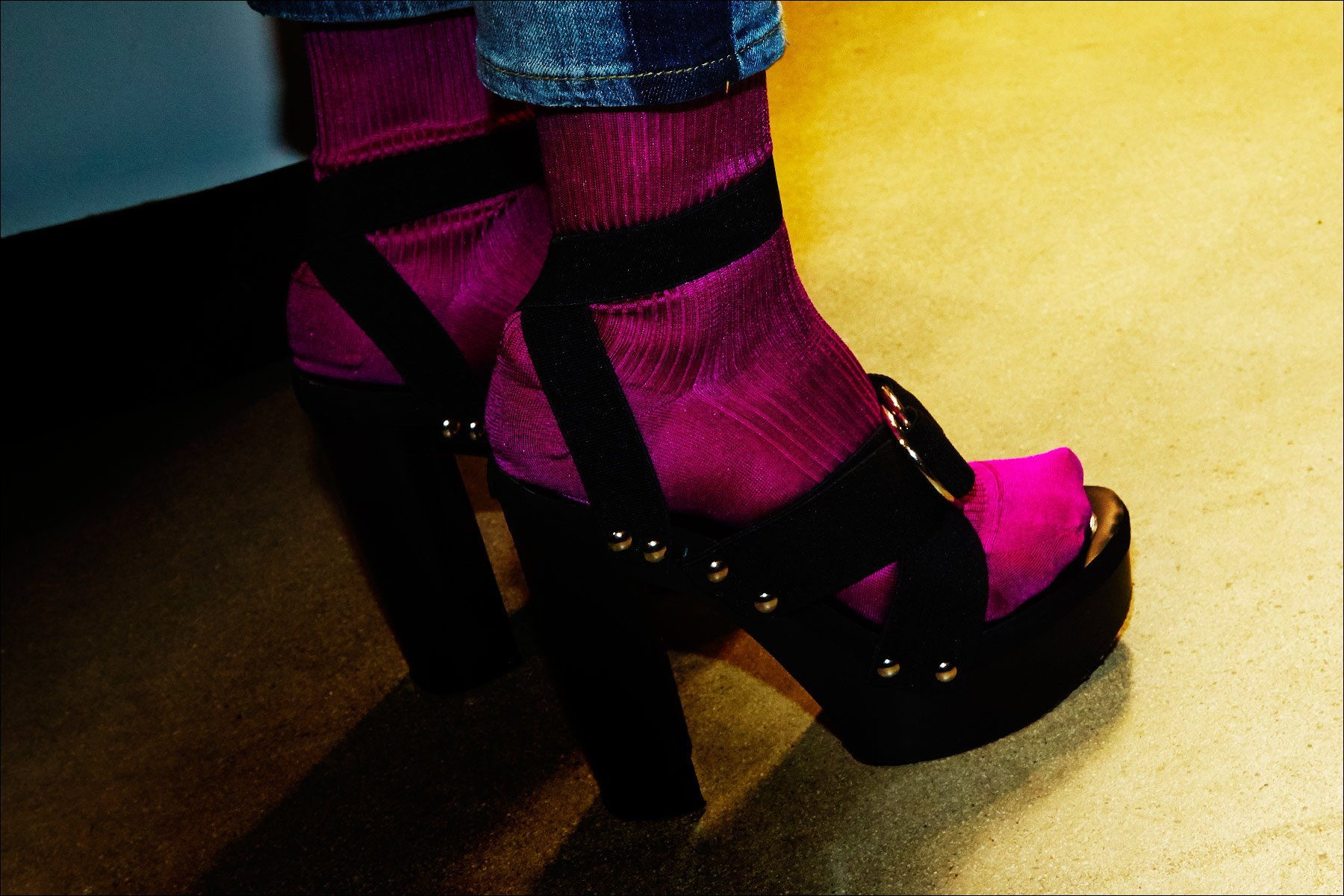 Studded platform shoes with vibrant fuchsia socks backstage at the Adam Selman Fall 2017 show. Photography by Alexander Thompson for Ponyboy magazine New York.
