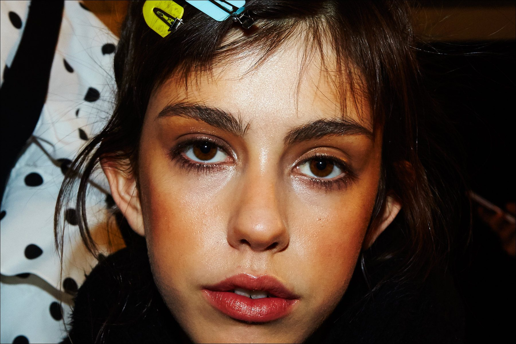 Model Mayka Merino snapped backstage in makeup at Adam Selman Fall 2017 womenswear show in New York City. Photography by Alexander Thompson.