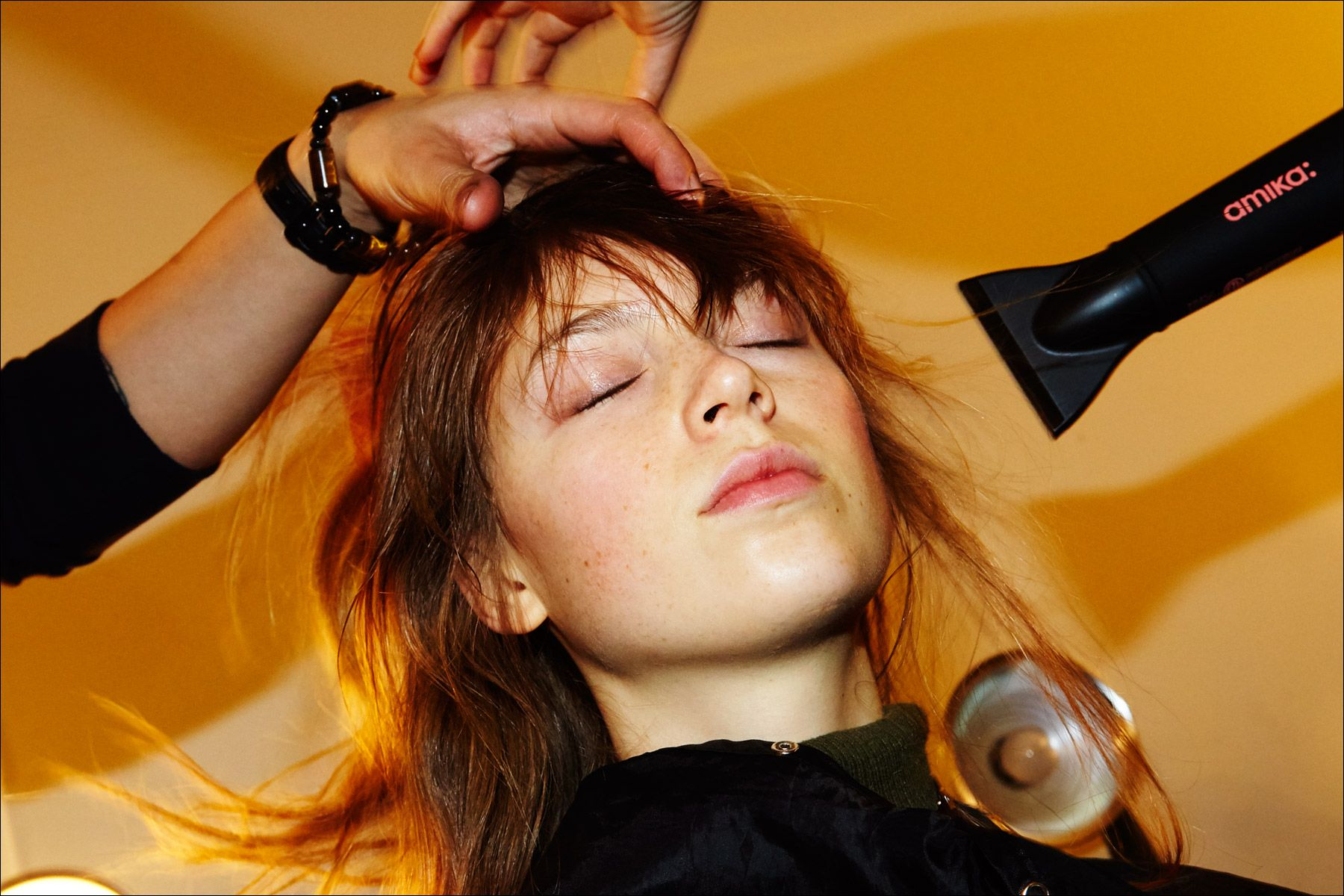A model gets a blowout backstage at the Adam Selman Fall 2017 womenswear show in New York City. Photography by Alexander Thompson for Ponyboy magazine New York.