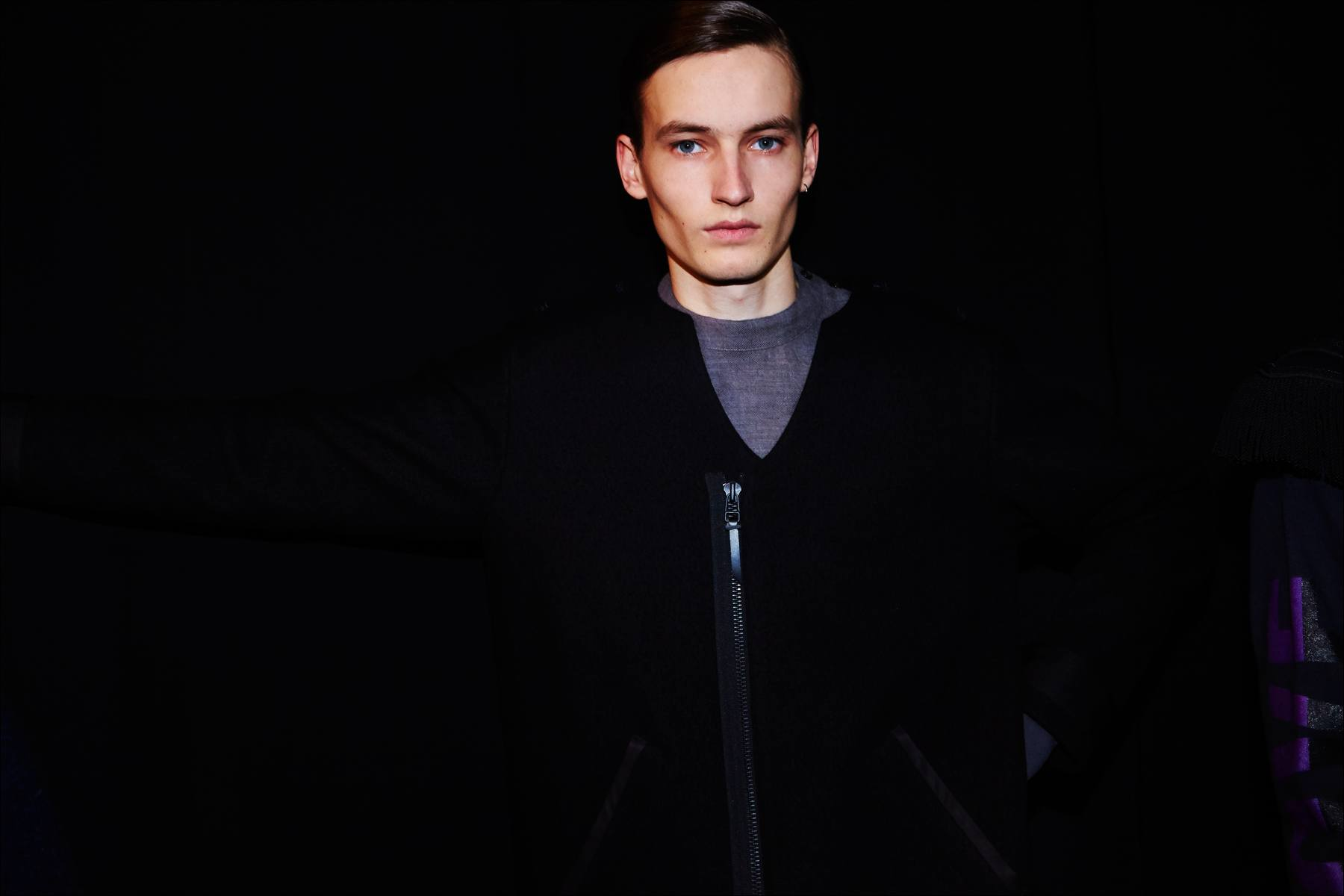 A male model photographed backstage at the Robert Geller Autumn/Winter 2017 menswear show in New York. Photography by Alexander Thompson for Ponyboy magazine.