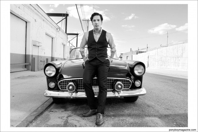 For Ponyboy Magazine, Ryan Matthew Cohn photographed in front of his convertible 1955 Ford Thunderbird in Greenpoint Brooklyn by Alexander Thompson.
