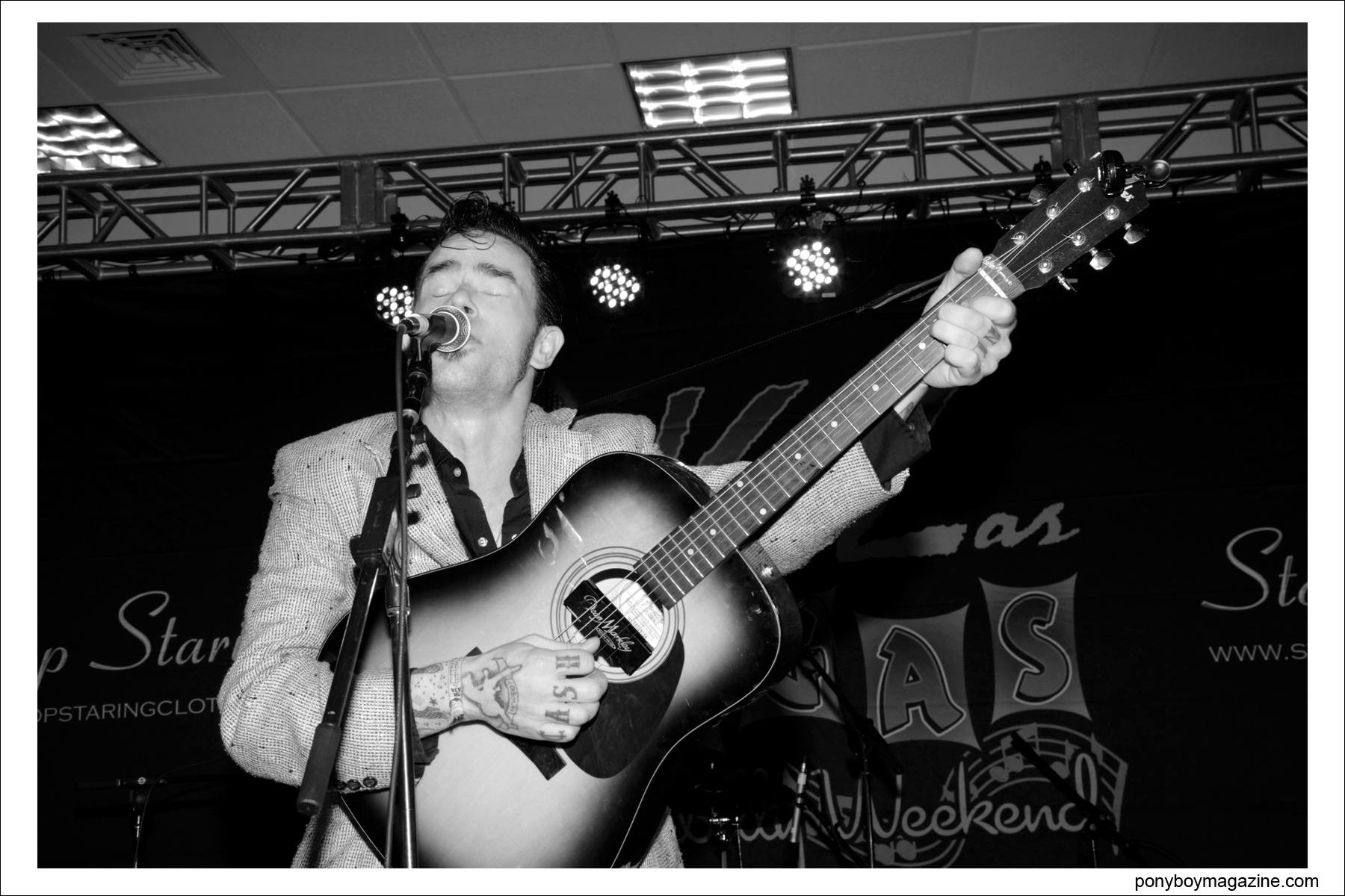 Cash O'Riley, rockabilly performer, sings on stage at Viva Las Vegas rockabilly weekender, photographed by Alexander Thompson for Ponyboy Magazine.