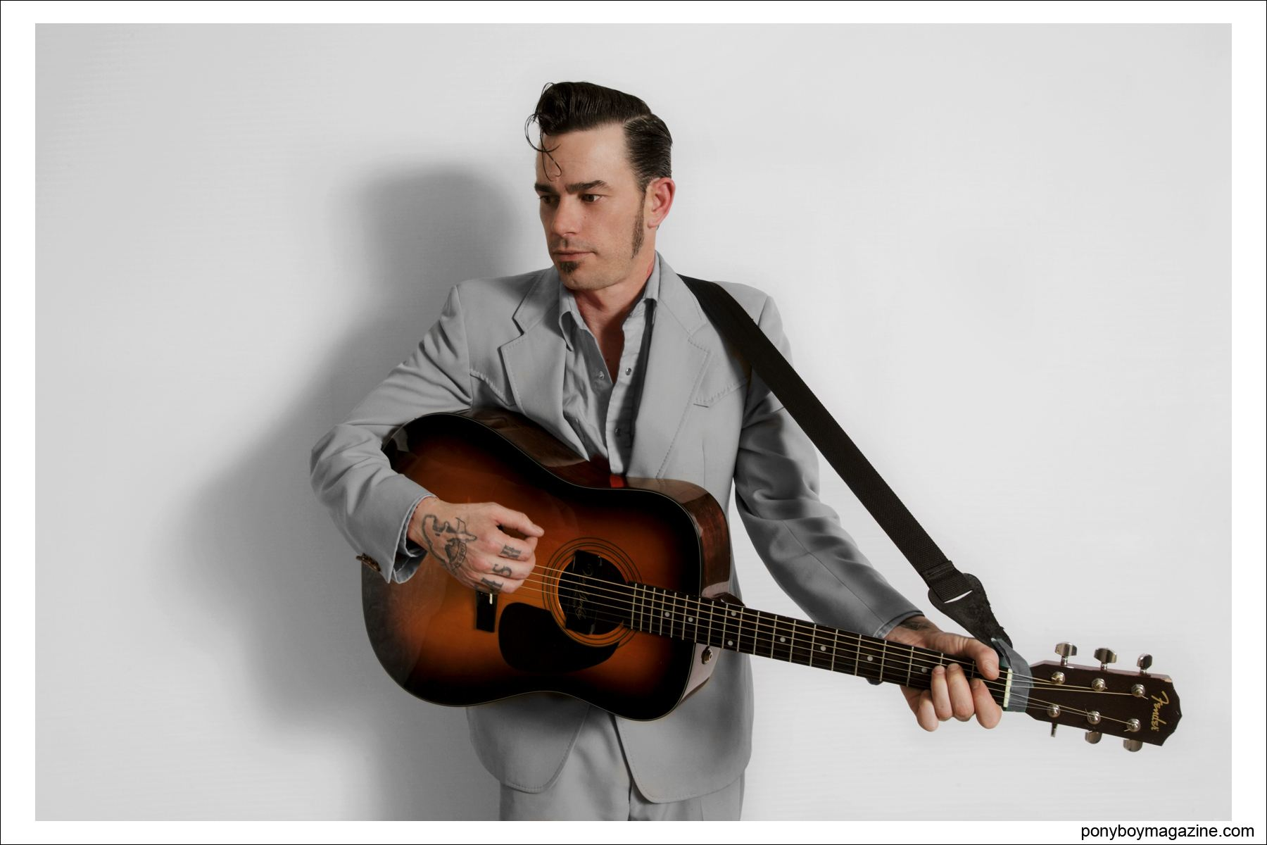 Musician Cash O'Riley photographed at VLV rockabilly weekender by Alexander Thompson for Ponyboy Magazine in NYC.