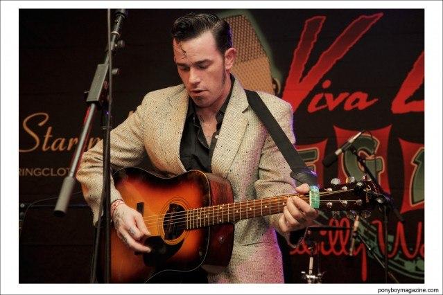 Rockabilly performer Cash O'Riley on stage at Viva Las Vegas by photographer Alexander Thompson for Ponyboy Magazine in New York City.