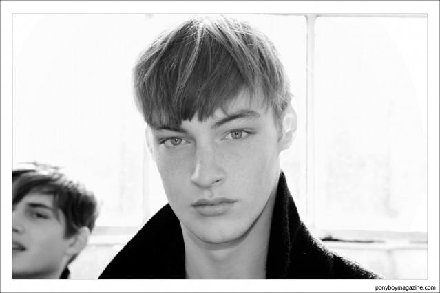 Male models backstage in New York City at Industria Studios, waiting to walk for Duckie Brown Autumn/Winter 2014. Photographed by Alexander Thompson for Ponyboy Magazine.