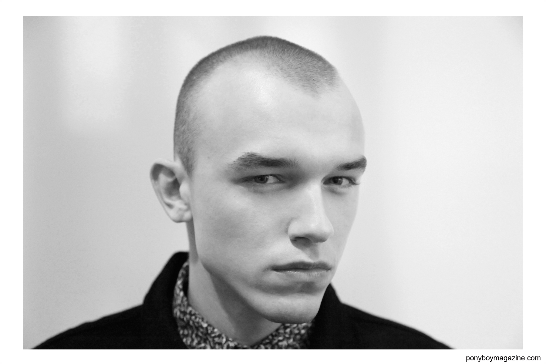 Portrait of a skinhead model, photographed backstage by Alexander Thompson for Ponyboy Magazine at the Duckie Brown A/W 2014 collection.