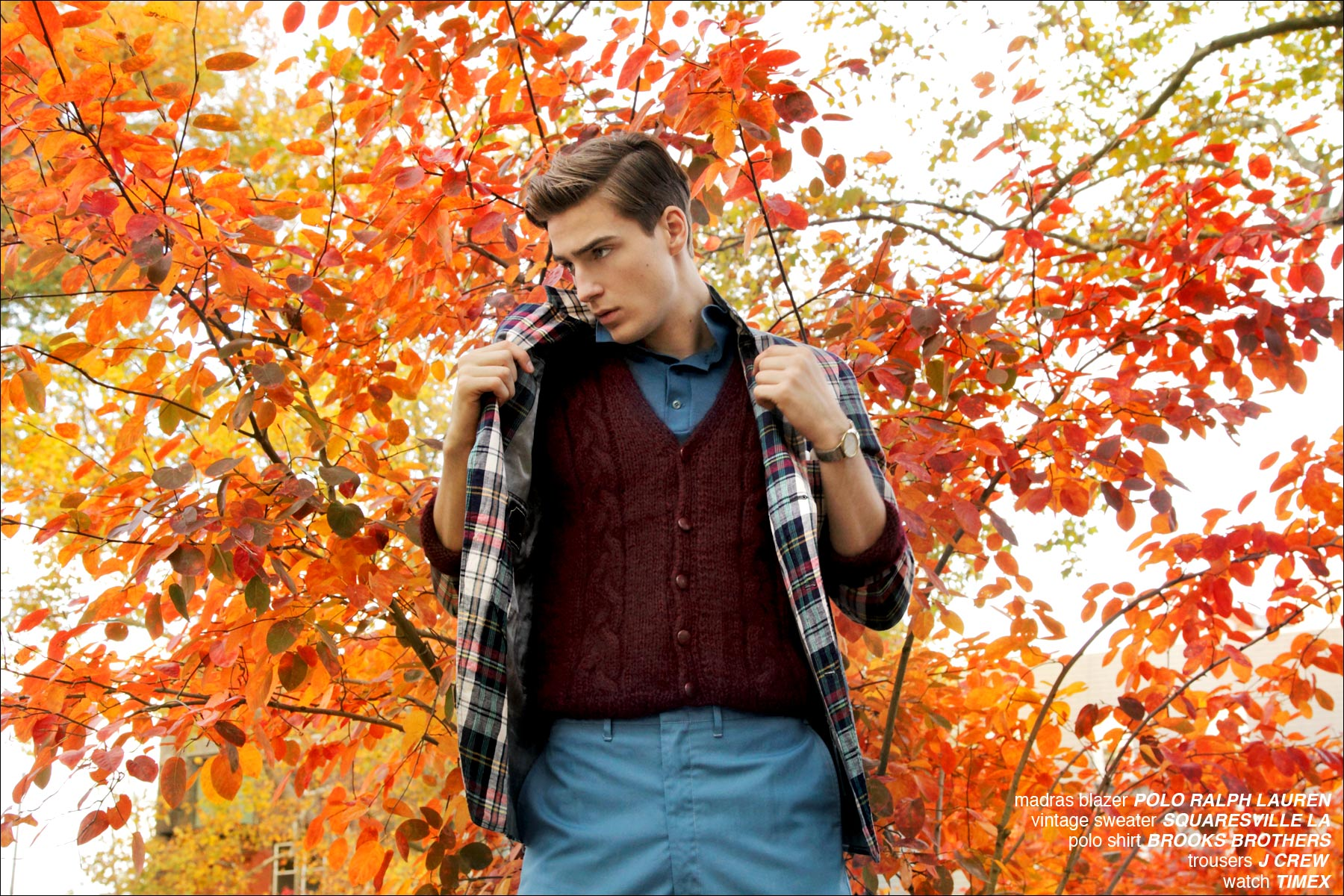 Model Samuel Roberts stands in front of fall foliage for the Ponyboy Magazine editorial