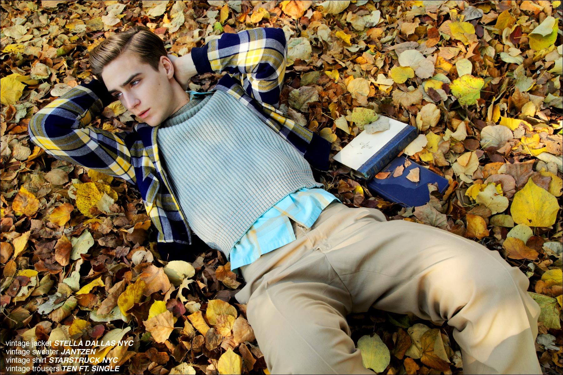 Model Samuel Roberts lays in a pile of leaves for a men's editorial for Ponyboy Magazine, photographed by Alexander Thompson in New York City.