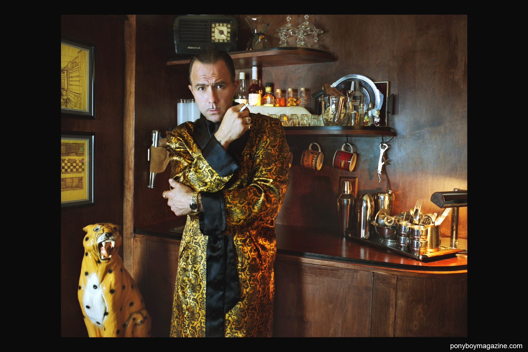 A silk robed Michele Savoia photographed in his haberdashery by Alexander Thompson for Ponyboy Magazine in New York City.