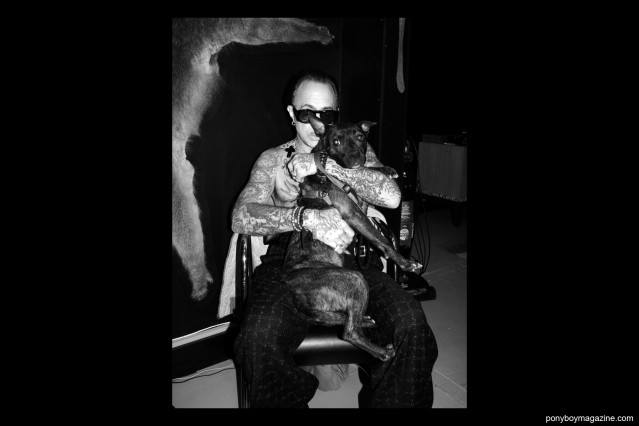 Michele Savoia with a pit bull puppy, photographed in New York City for Ponyboy Magazine by Alexander Thompson.