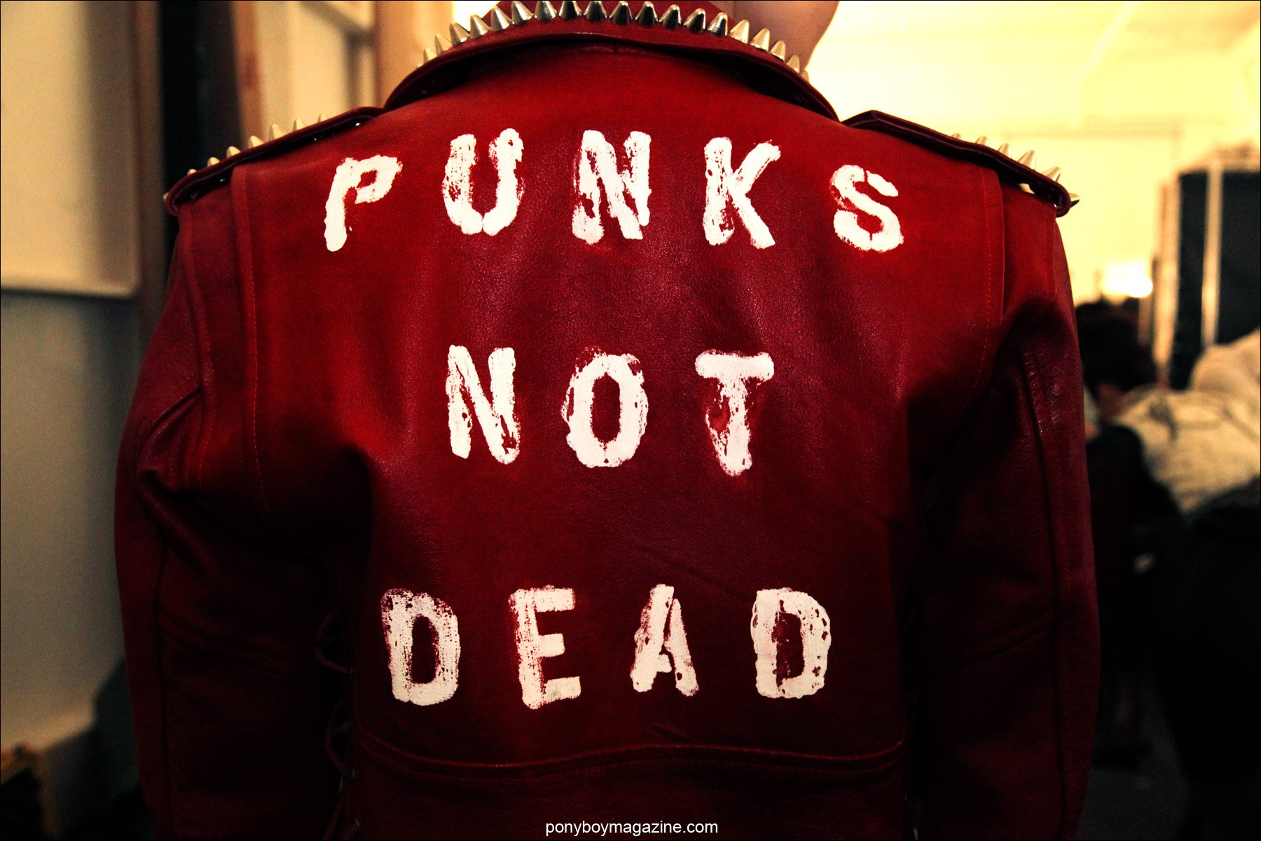 Punks Not Dead, back of a custom leather jacket by designer Christian Benner, for his A/W 2014 Collection at Pier 59 Studios in New York City. Photographed for Ponyboy Magazine by Alexander Thompson.