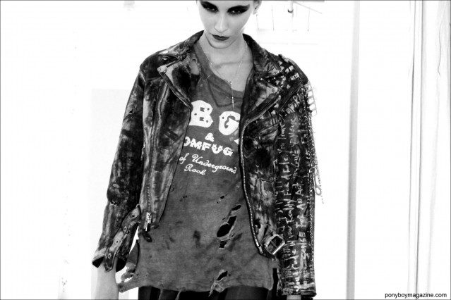 A custom leather jacket and distressed CBGB's t-shirt, photographed at Pier 59 Studios in New York City by Alexander Thompson for Ponyboy Magazine, Christian Benner A/W 2014 Collection.