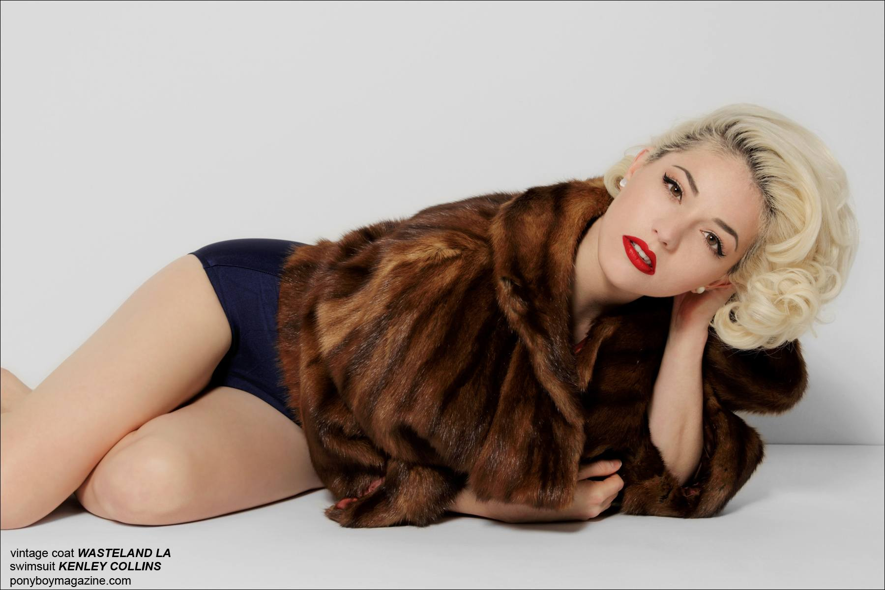 Designer Kenley Collins modelis a vintage fur cape for Ponyboy Magazine, photographed by Alexander Thompson.