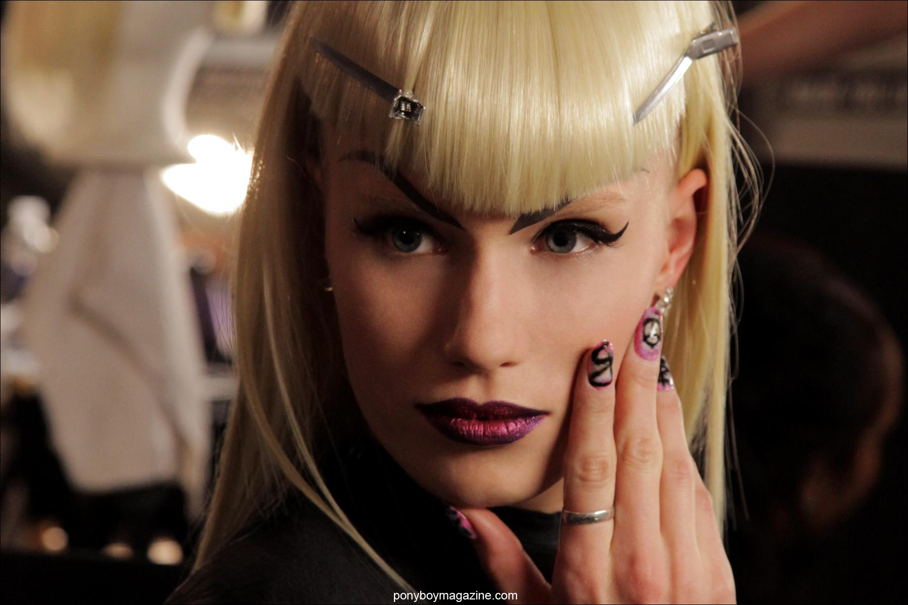 A model shows off her elaborately painted nails at The Blonds A/W 2014 fashion show. Photograph taken for Ponyboy Magazine by Alexander Thompson.
