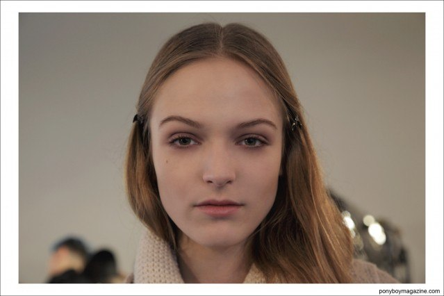 Model photographed backstage by Alexander Thompson for Ponyboy Magazine in New York City at the Timo Weiland A/W 2014 collection.