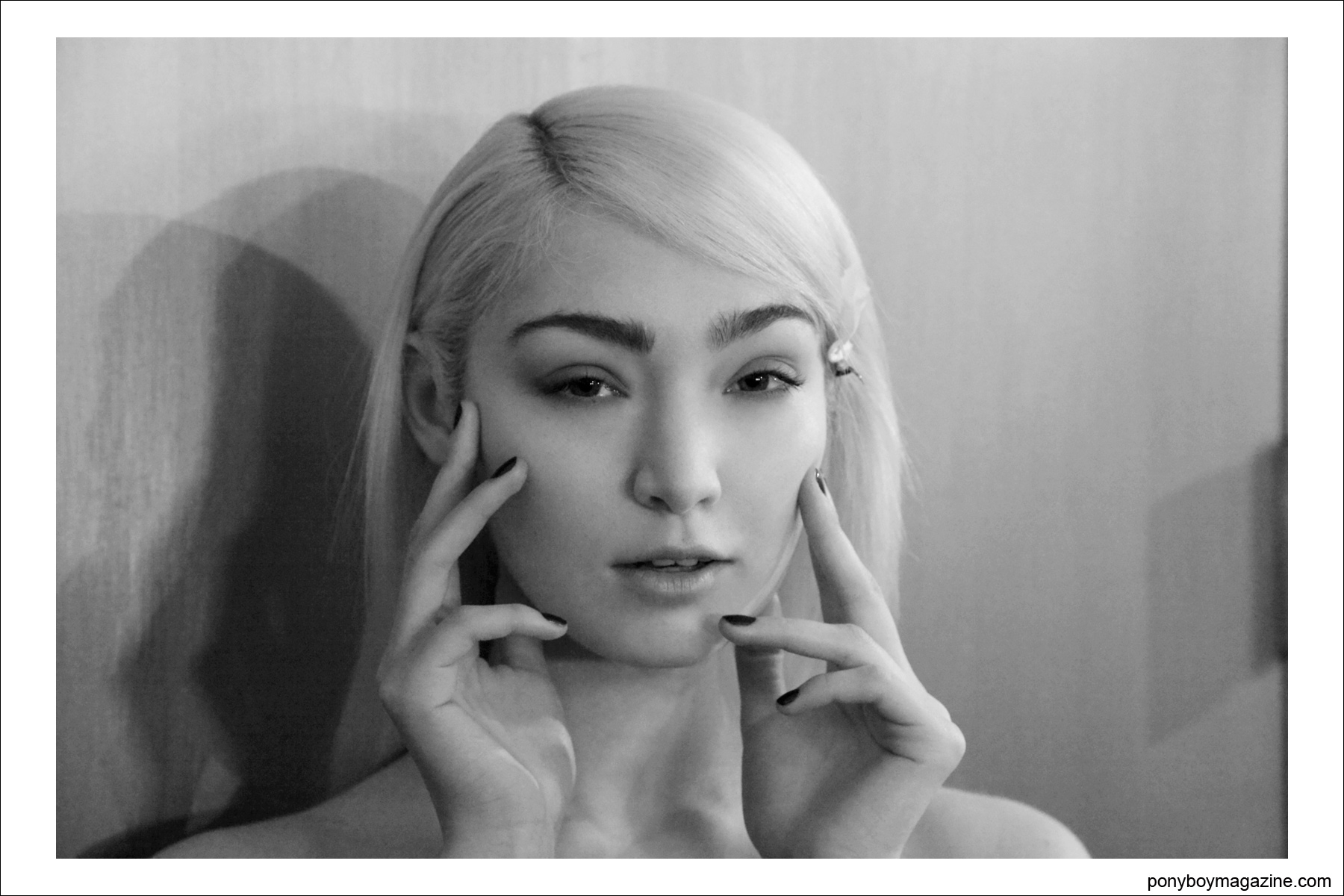 A blonde Asian beauty poses for photographer Alexander Thompson, backstage at the Timo Weiland A/W 2014 Collection at Milk Studiosin New York city, for Ponyboy Magazine.
