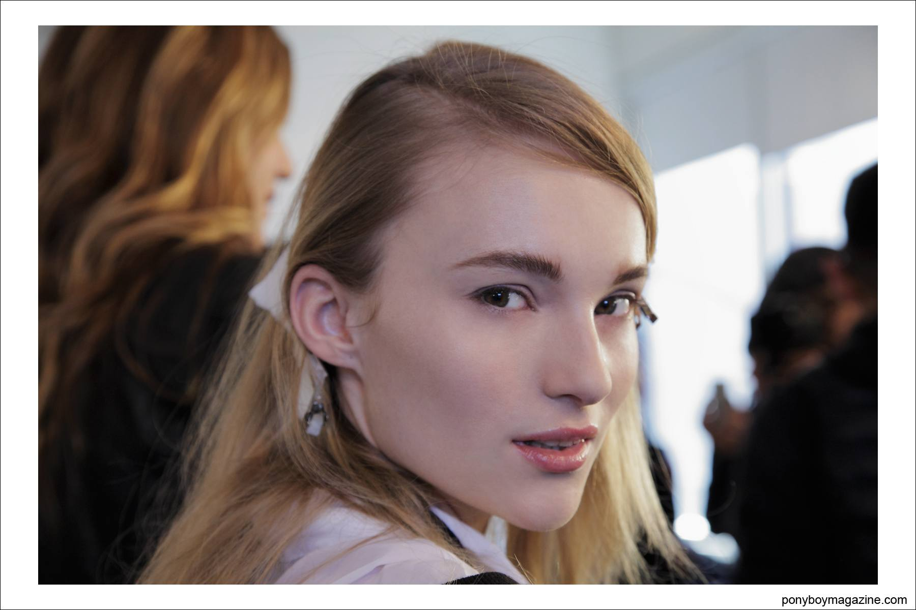 A model in hair and makeup poses backstage at Timo Weiland A/W 2014 collection at Milk Studios. Photographed by Alexander Thompson for Ponyboy Magazine in New York City.
