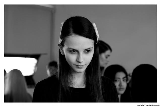 Brunette model photographed backstage by Alexander Thompson at Timo Weiland A/W 2014 womenswear collection for Ponyboy Magazine.