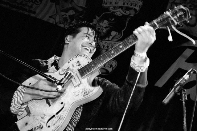 Rockabilly performer Bloodshot Bill live on stage, photographed by Alexander Thompson for Ponyboy Magazine in New York City.