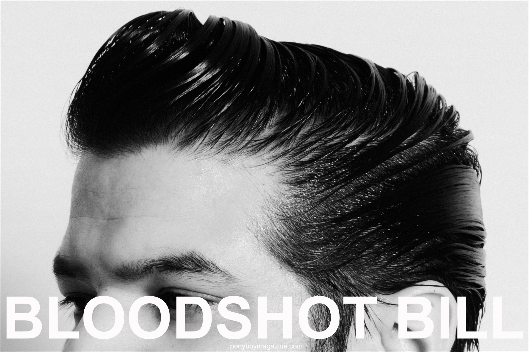 Close-up image of Bloodshot Bill pompadour by Alexander Thompson for Ponyboy Magazine.