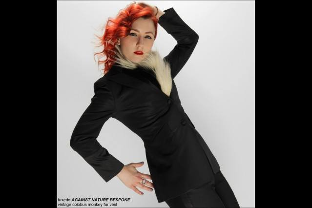 An image of Amber Doyle in an Against Nature Bespoke suit, photographed by Alexander Thompson for Ponyboy Magazine.