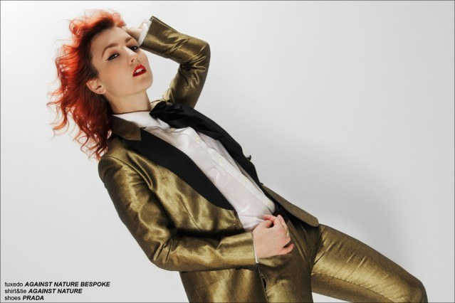 Against Nature designer Amber Doyle photographed in a gold teddy boy suit for Ponyboy Magazine by Alexander Thompson.