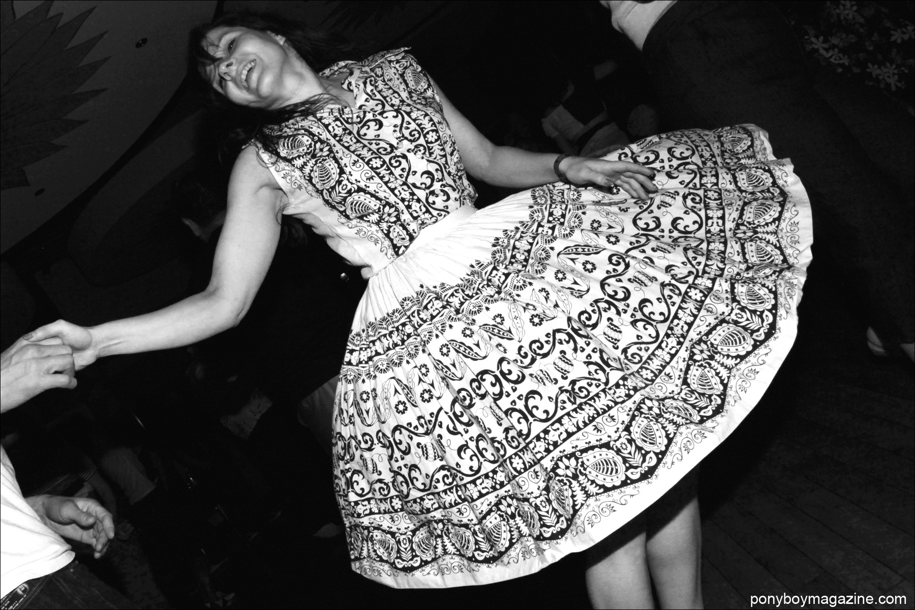 A young rockabilly dancer in a full skirt photographed by Alexander Thompson for Ponyboy Magazine at Tom Ingram's Viva Las Vegas 17 weekender.
