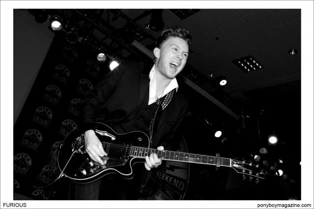 Andy Halligan from teddy boy band Furious performs on stage at Viva Las Vegas 17 rockabilly weekender, photographed by Alexander Thompson for Ponyboy Magazine.