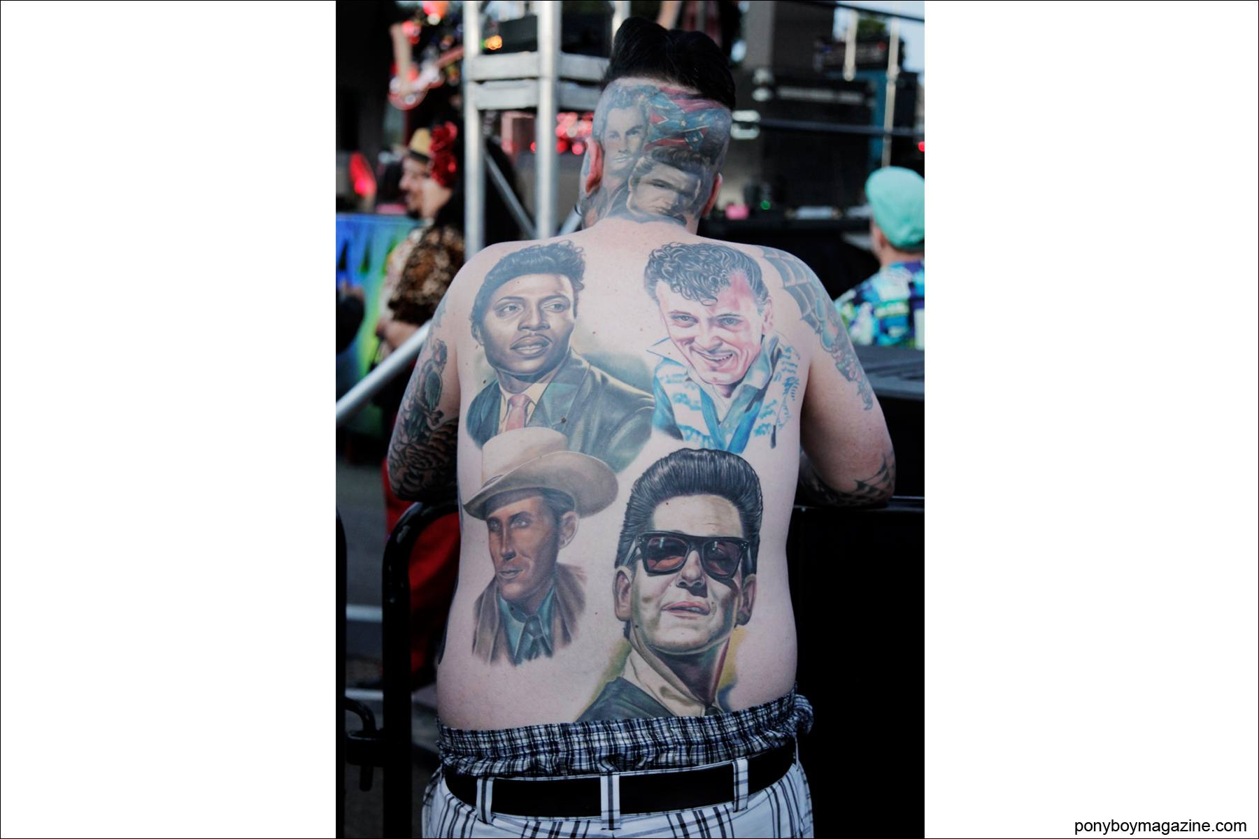 A tattooed rockabilly fan watched Robert Gordon onstage at Tom Ingram's Viva Las Vegas 17 weekender. Photograph by Alexander Thompson for Ponyboy Magazine.