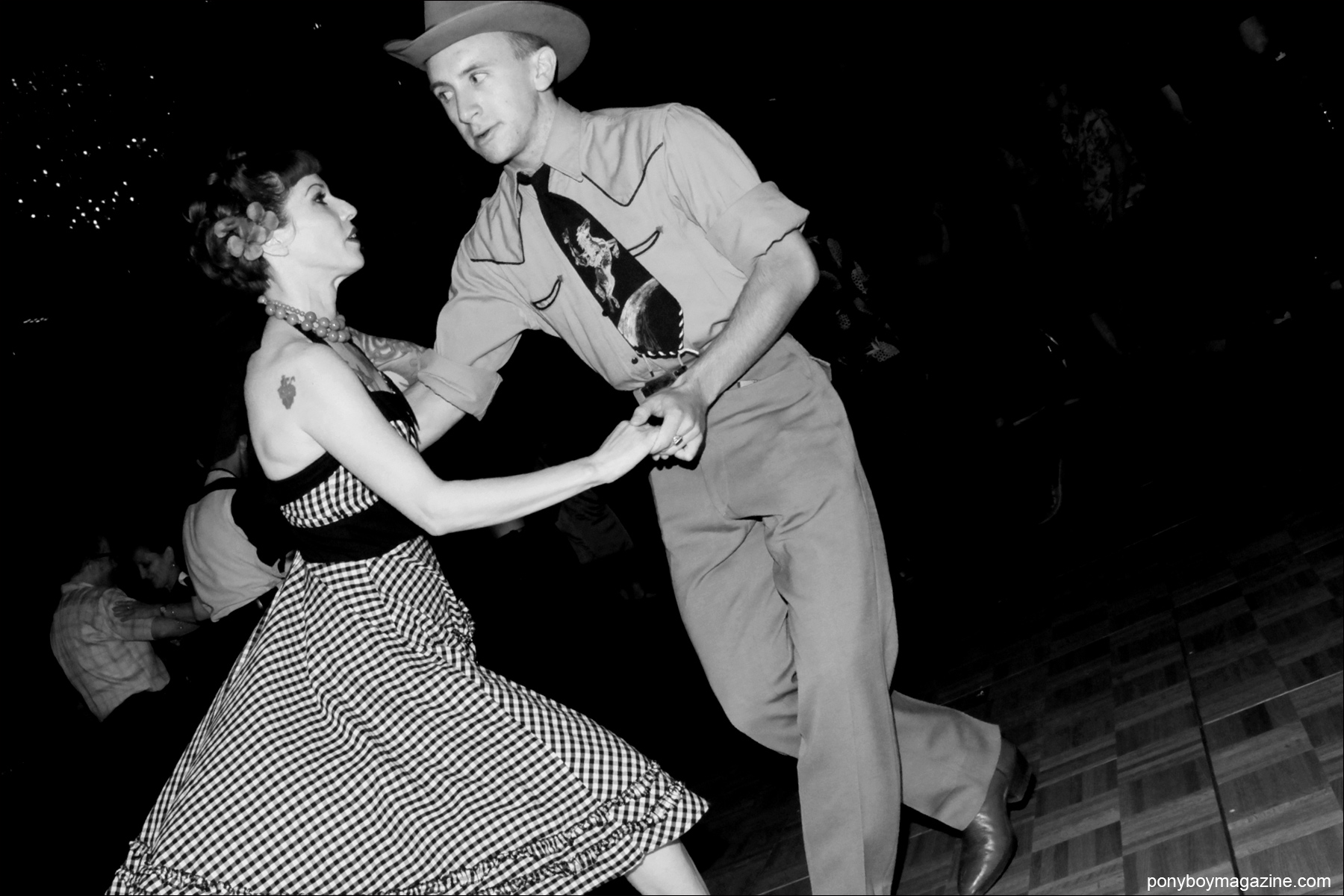 A rockabilly couple on the dance floor at Tom Ingram's annual Viva Las Vegas 4 day weekender. Photograph by Alexander Thompson for Ponyboy Magazine.