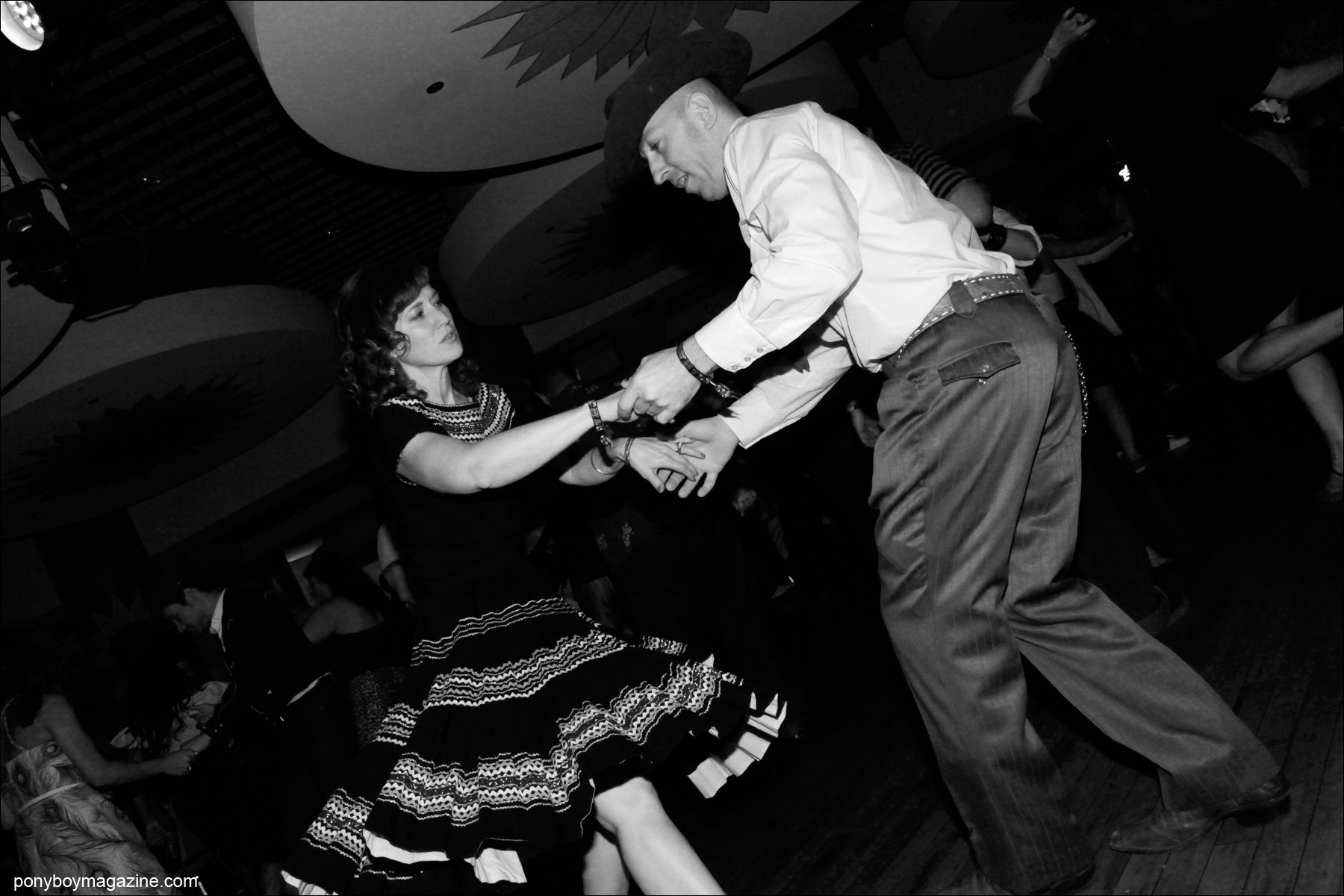 A western couple on the dance floor at Tom Ingram's annual rockabilly weekender Viva Las Vegas. Photograph taken by Alexander Thompson for Ponyboy Magazine.