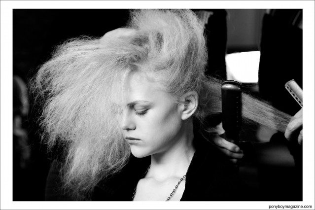 A model gets her hair styled at Alexandre Herchcovitch A/W 2014. Photographed exclusively for Ponyboy Magazine by Alexander Thompson in New York City.