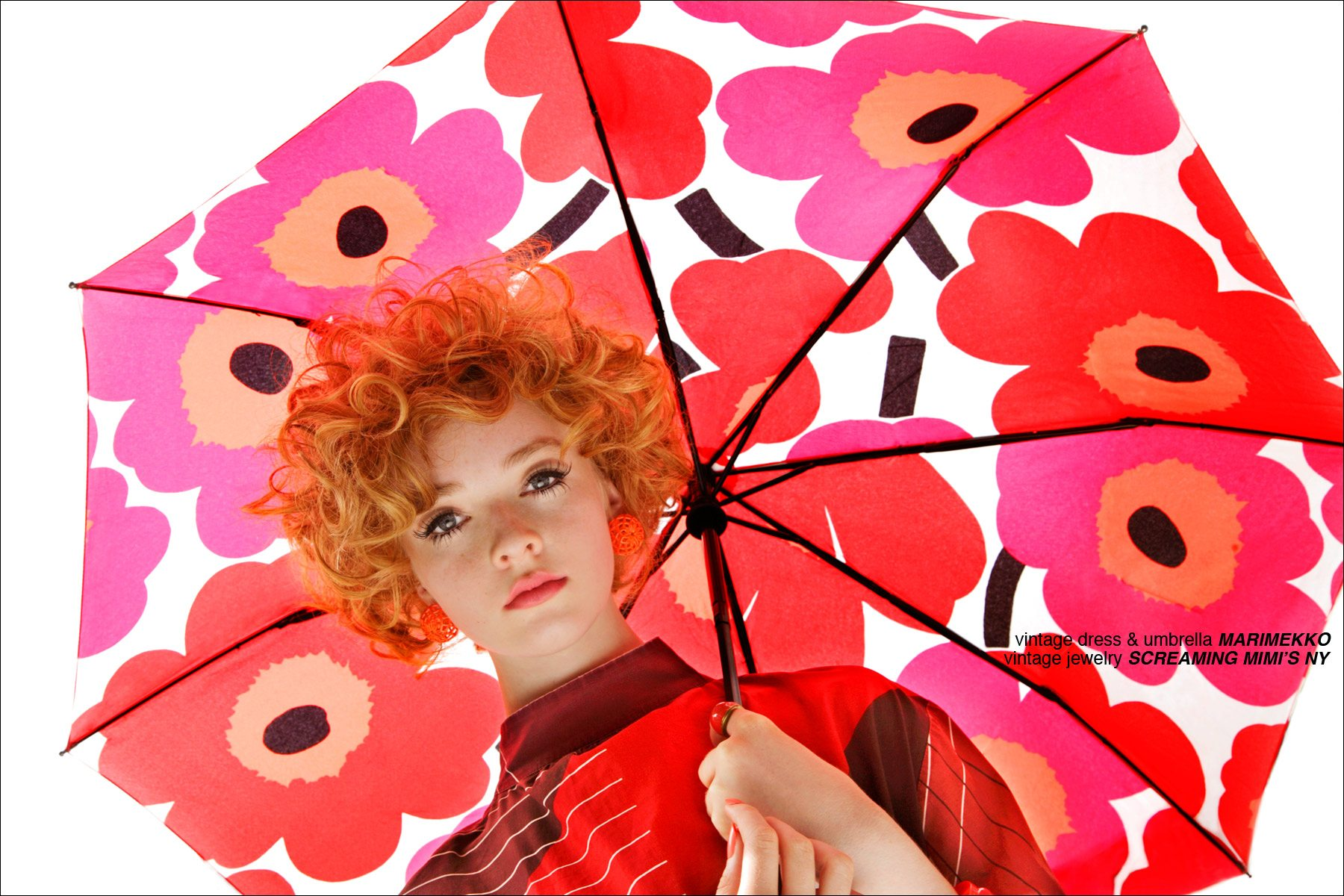 A model holds a Marimekko floral umbrella, photographed by Alexander Thompson for Ponyboy Magazine in New York City.