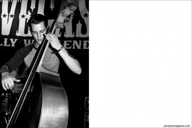 Upright bassist for rockabilly trio Pat Capocci, photographed at Tom Ingram's Viva Las Vegas by Alexander Thompson for Ponyboy Magazine.