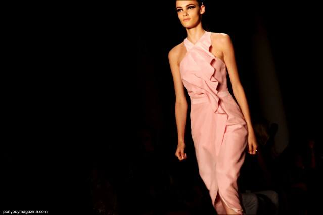 A model in a pink dress by Cushnie et Ochs S/S 2015. Photographed by Alexander Thompson at Milk Studios in New York City for Ponyboy Magaine.