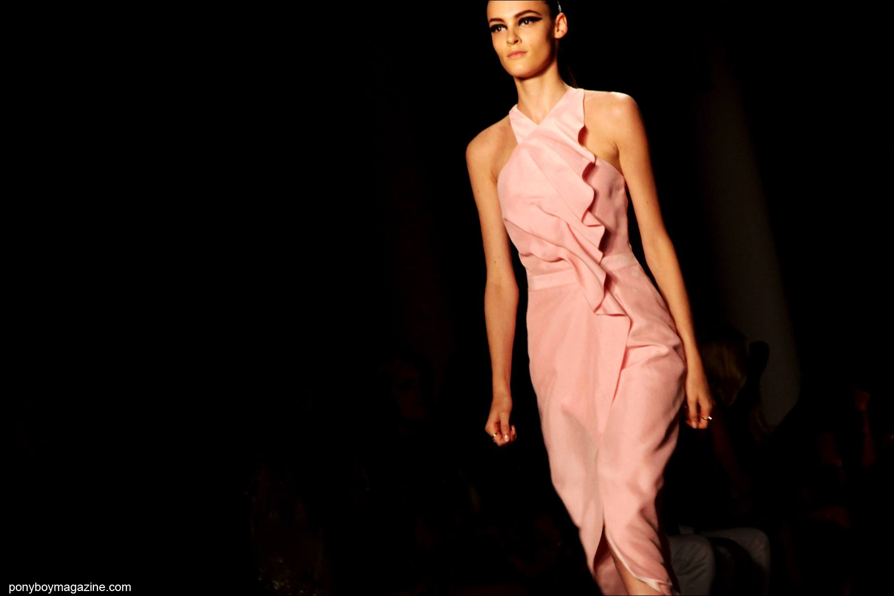 A model wears a pink dress on the catwalk for Cushnie et Ochs S/S15. Photographed for Ponyboy Magazine by Alexander Thompson at Milk Studios.