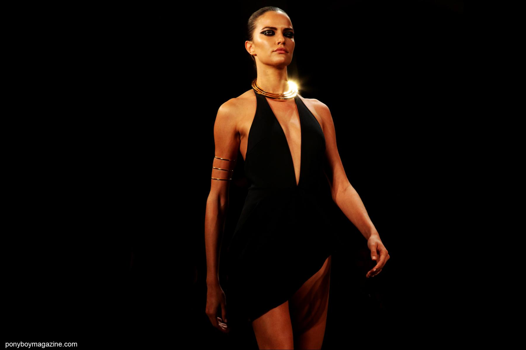 A model in a low-cut dress, on the runway for Cushnie et Ochs S/S15. Photo by Alexander Thompson for Ponyboy Magazine in New York City.