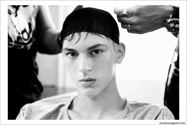 AS Management model Dominik Sadoch photographed backstage at Tim Coppens S/S15. Photo by Alexander Thompson for Ponyboy Magazine.