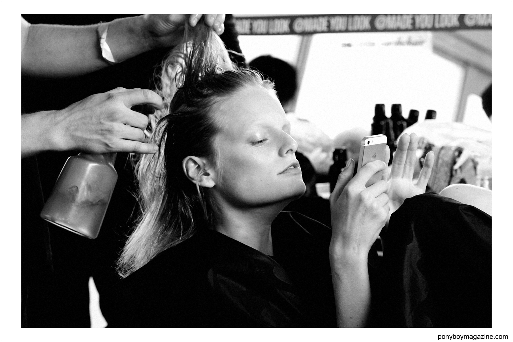 Hanne Gaby Odiele photographed backstage during hair/makeup at Tim Coppens S/S15 at Milk Studios in New York. Photograph by Alexander Thompson for Ponyboy Magazine.