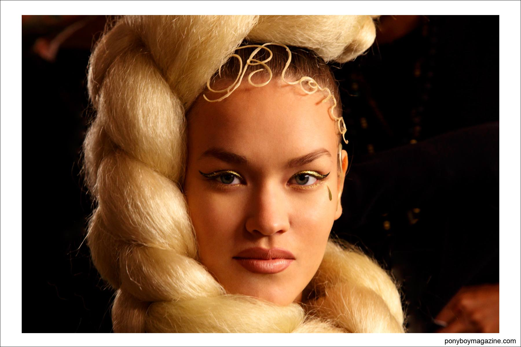 A portrait of a model with a huge braid, photographed backstage at The Blonds S/S15. Photograph taken by Alexander Thompson for Ponyboy Magazine.