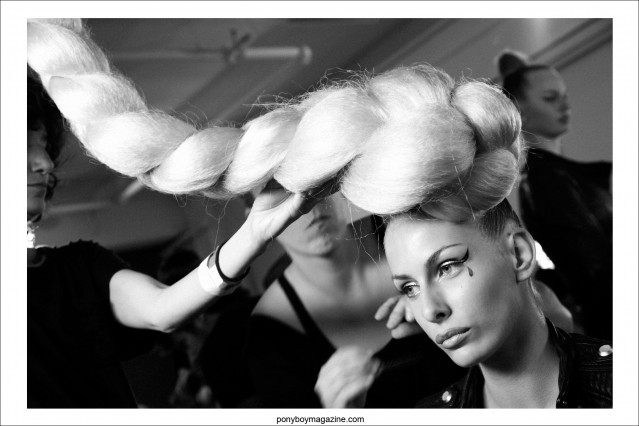 A model gets her oversized braid adjusted, backstage at The Blonds S/S15 show. Photographed in New York City by Alexander Thompson for Ponyboy Magazine.
